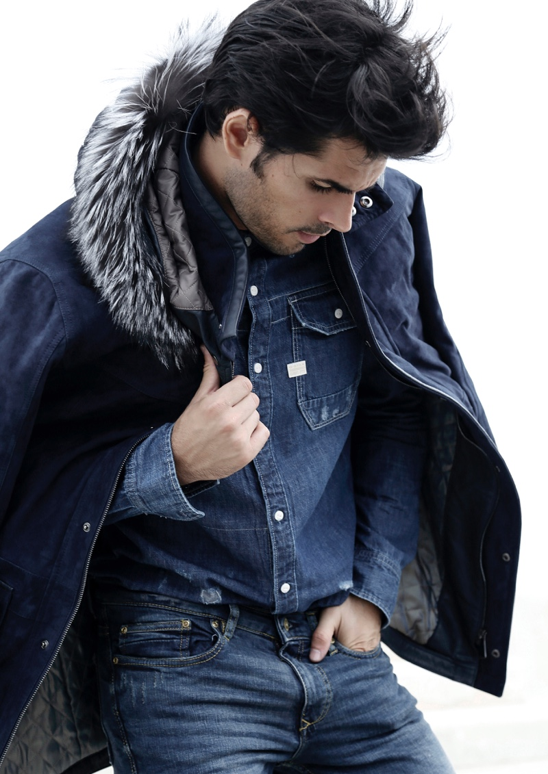Raul wears denim shirt G-Star Raw, jeans GUESS, and jacket Torras.