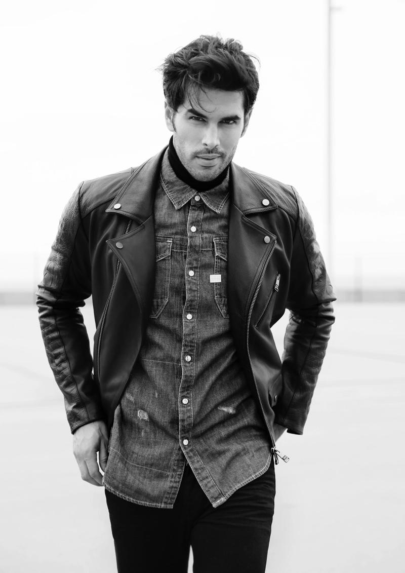 Raul wears denim shirt G-Star Raw, leather biker jacket Bikkembergs, jeans GUESS, and turtleneck American Apparel.