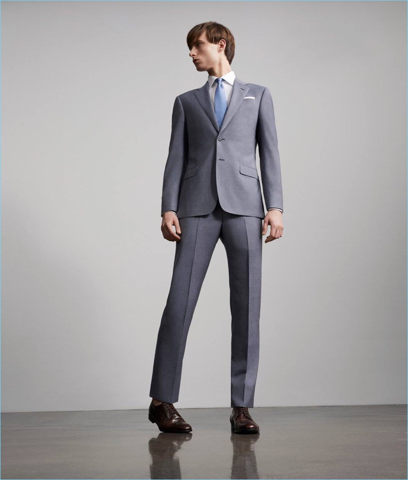 A sharp vision, Laurie Harding dons a suit by Giorgio Armani.