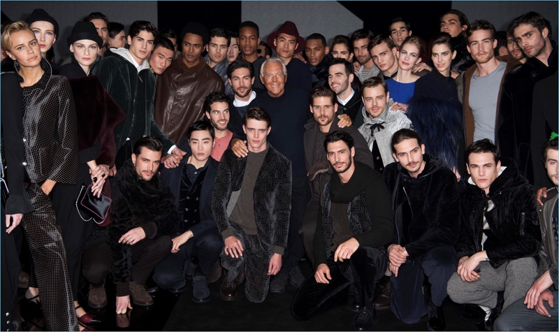 Giorgio Armani poses for pictures with the models who walked his namesake show for fall-winter 2017.