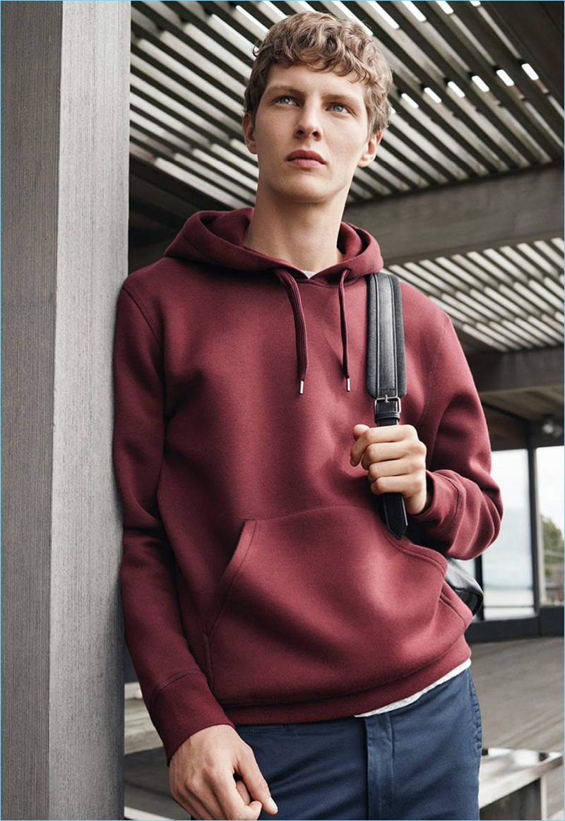 Going casual, Tim Schuhmacher rocks a hooded sweatshirt with cotton twill pants.