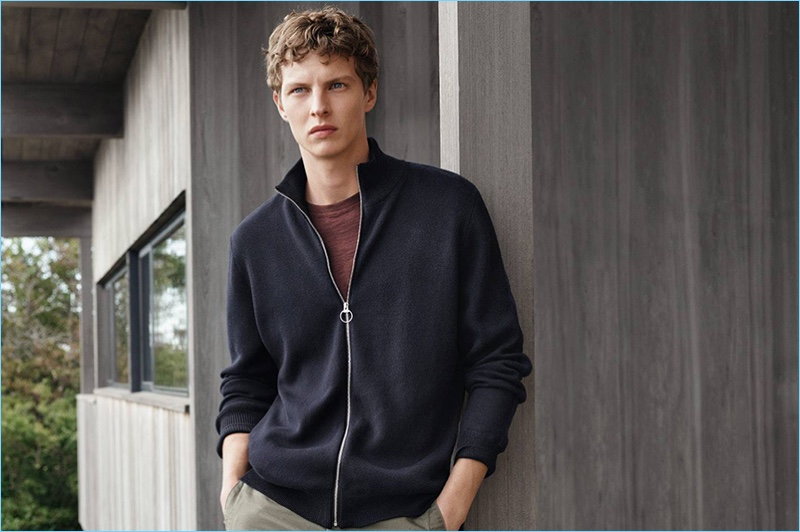 Tim Schuhmacher wears a full-zip cardigan sweater with a t-shirt and slim-fit pants.