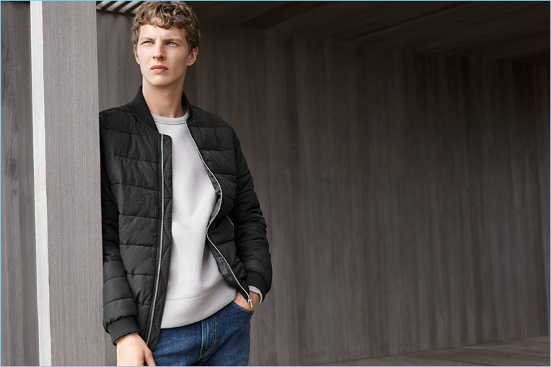 Tim Schuhmacher wears a padded bomber jacket with a sweatshirt and denim jeans from H&M.