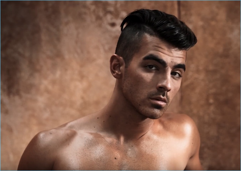 Channeling his inner model, Joe Jonas appears in a video still for his GUESS Underwear campaign.