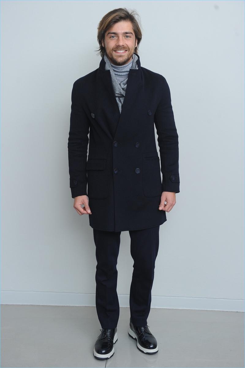 Lourenço Ortigão wears Emporio Armani for the brand's fall-winter 2017 show.