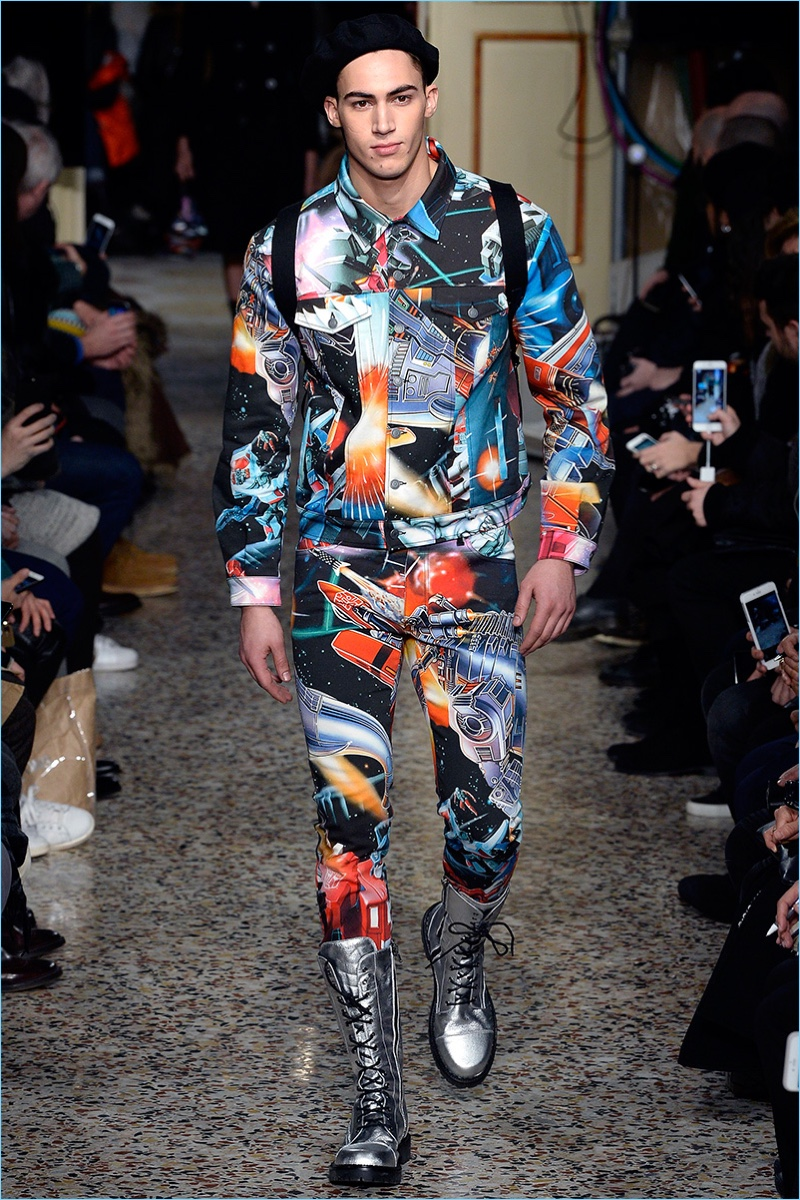 Alessio Pozzi takes to the catwalk in a graphic ensemble featuring an all-over Transformers print.