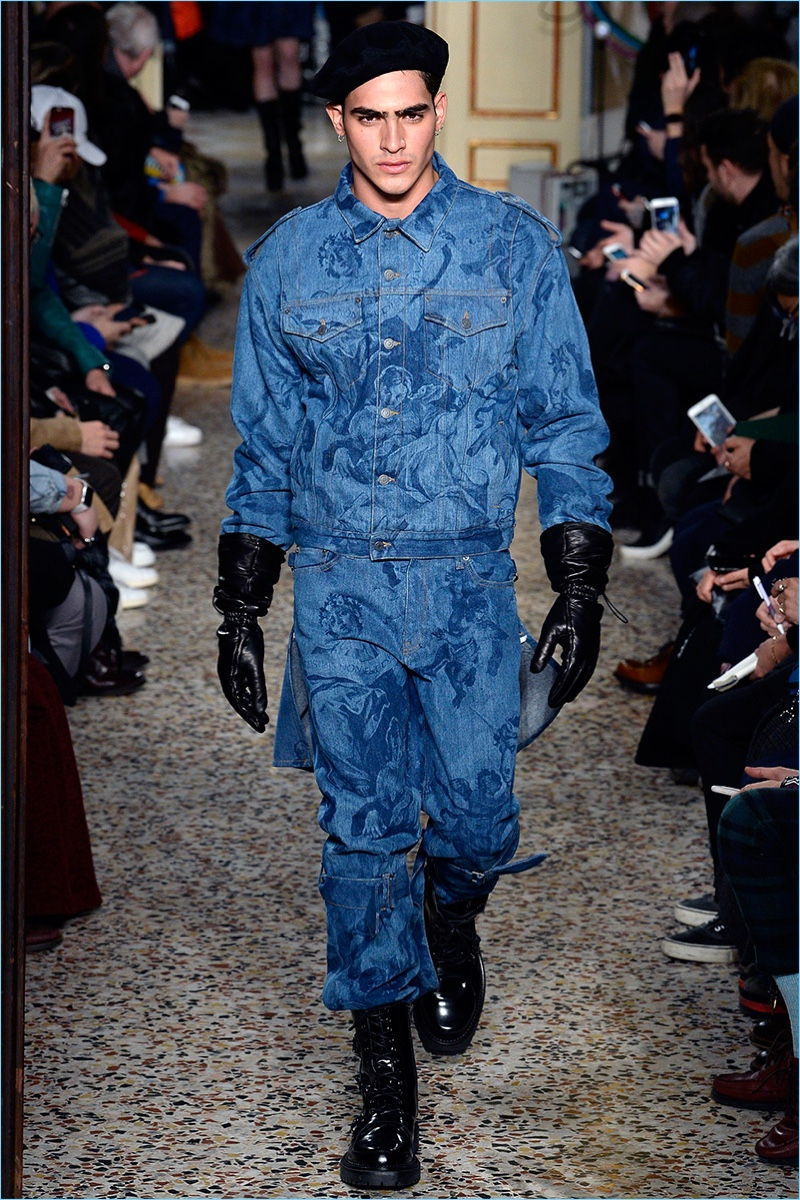 Jhon Burjack sports a double denim ensemble from Moschino's fall-winter 2017 men's collection.