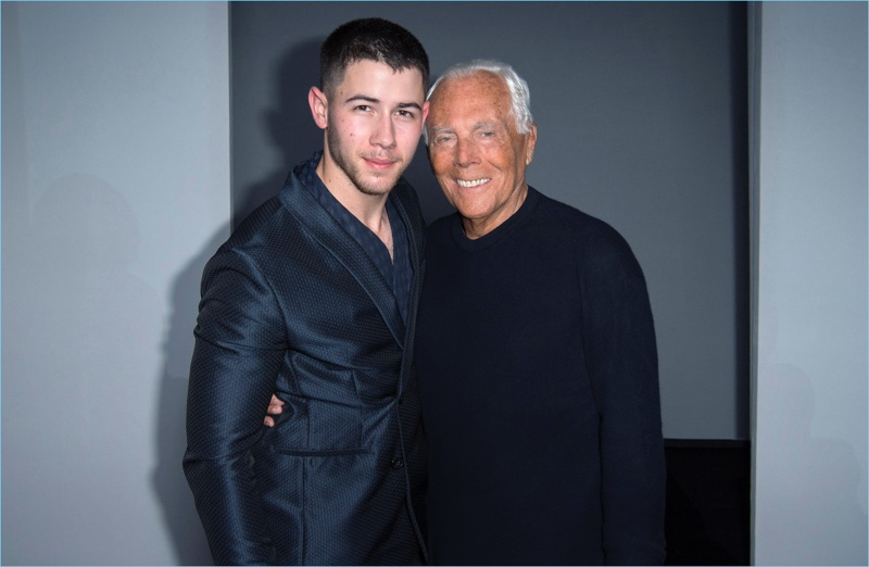 Nick Jonas poses for pictures with Giorgio Armani.