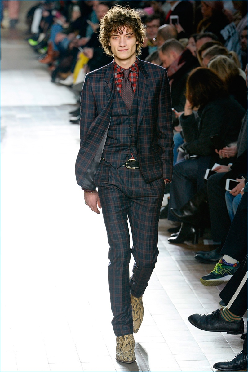 Paul Smith mixes various plaids for a statement fall-winter 2017 suiting look.