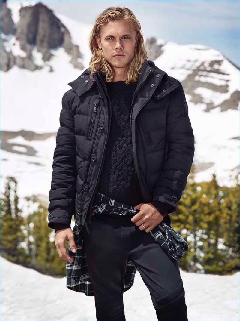 Christopher Mason models a navy down jacket from Polo Ralph Lauren.