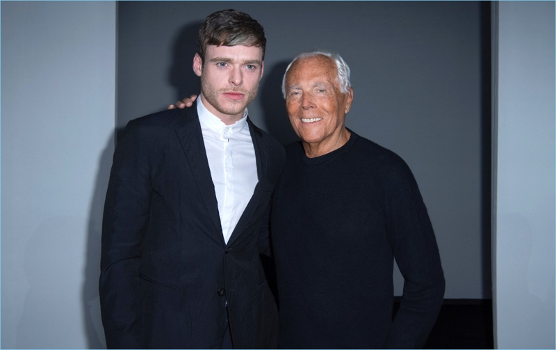 Actor Richard Madden poses for pictures with Giorgio Armani.