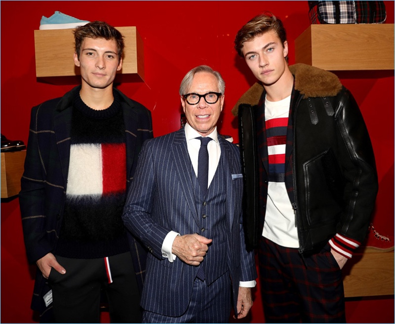 Tommy Hilfiger poses for pictures with Julian Ocleppo and Lucky Blue Smith.