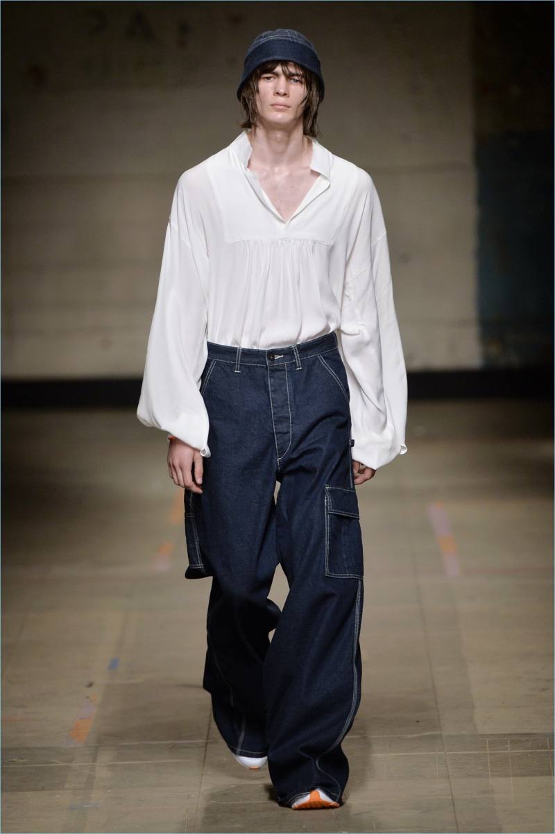 Evoking 90s style, Topman Design gravitates towards baggy denim jeans for fall-winter 2017.