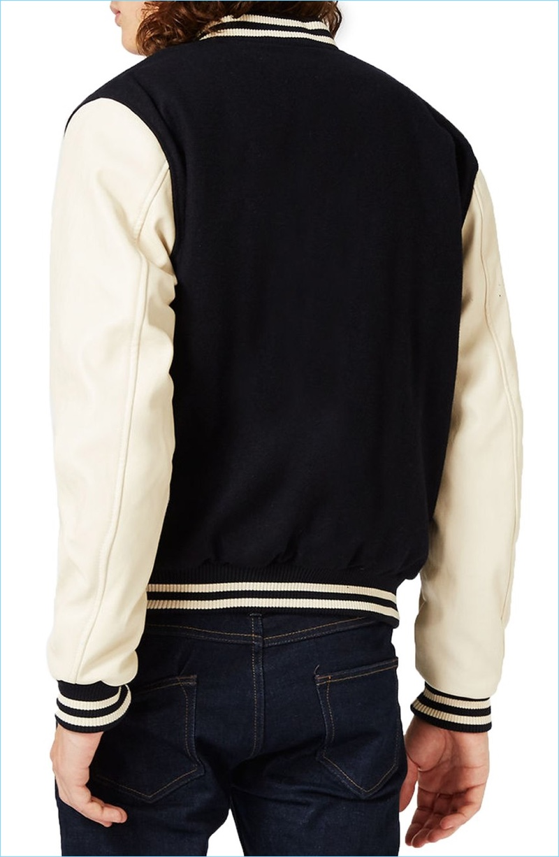Topman's varsity bomber jacket comes in a smart dark blue and cream color palette.