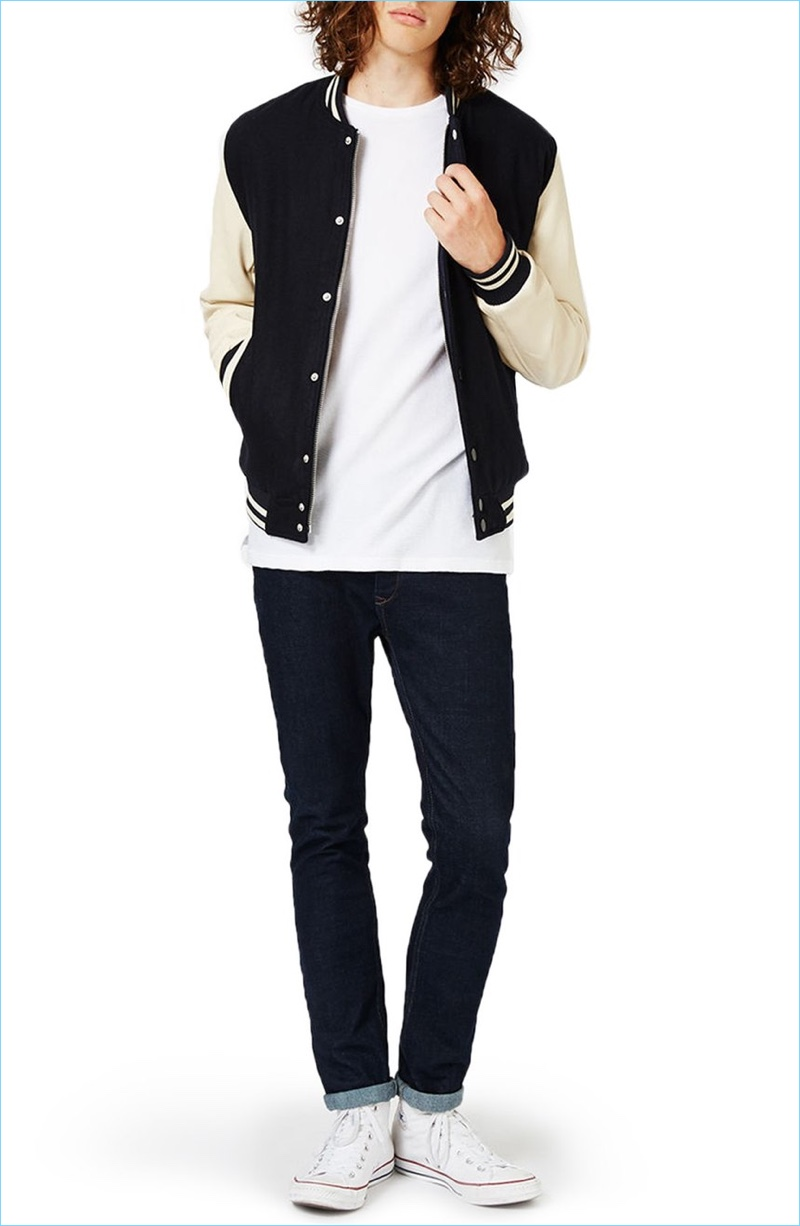 Nordstrom styles Topman's varsity bomber jacket with a simple tee, skinny jeans, and white sneakers.
