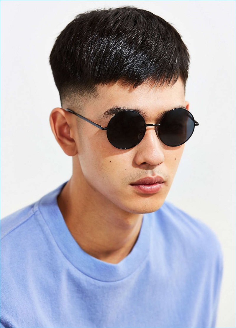 Retro round sunglasses with 100% UV protected lenses. Exposed metal arms with plastic-coated curved tips. Finished with slip-proof silicone nose guards. Only at UO.
