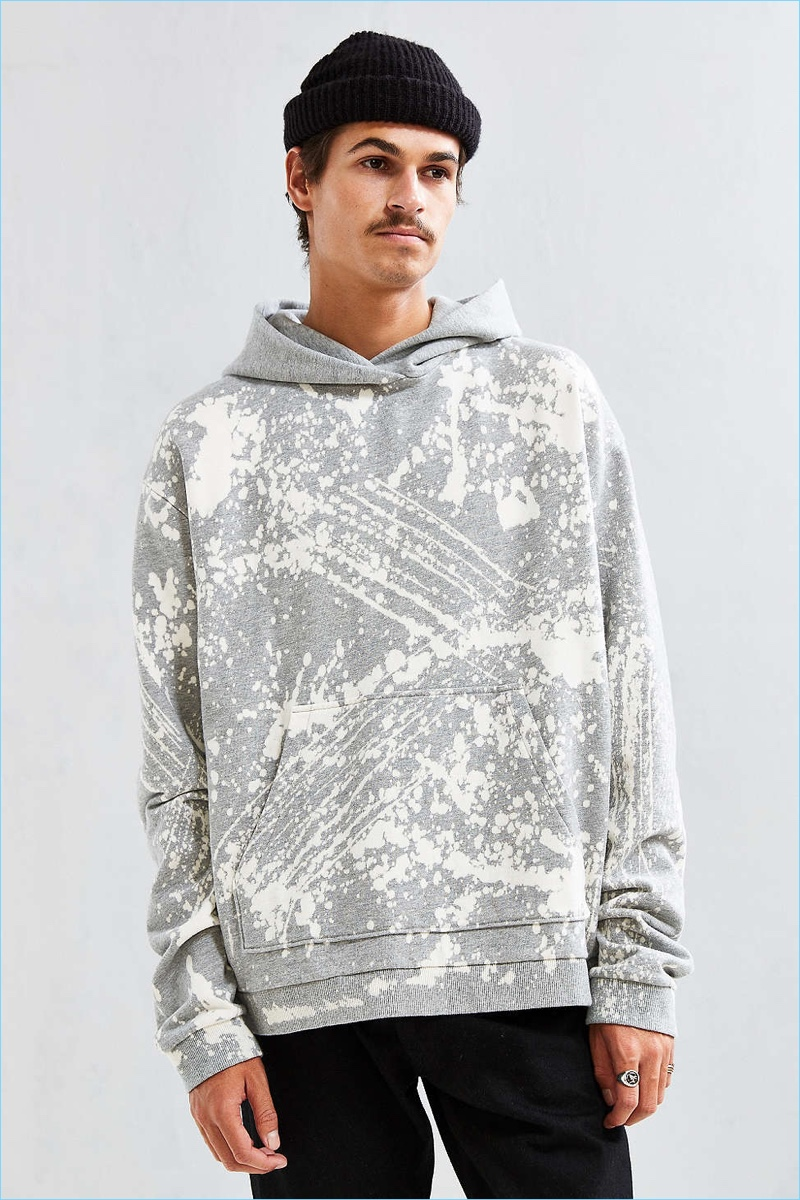 We bleached your favorite hoodie from Urban Outfitters for a prismatic crystal wash finish. Cut in a slightly boxy pullover silhouette offering a fixed hood and front kanga pocket, complete with rib-knit banding at the cuffs + hem for the perfect fit. Each hoodie is customized by hand for a totally unique look -- the one you'll receive will vary slightly in bleach pattern from the photo!