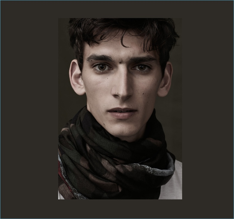 Model Thibaud Charon wears a camouflage print scarf from Italian fashion house, Valentino.