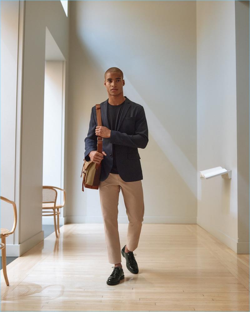 A smart vision, Malik Lindo sports WANT Les Essentiels' messenger bag and dress shoes.