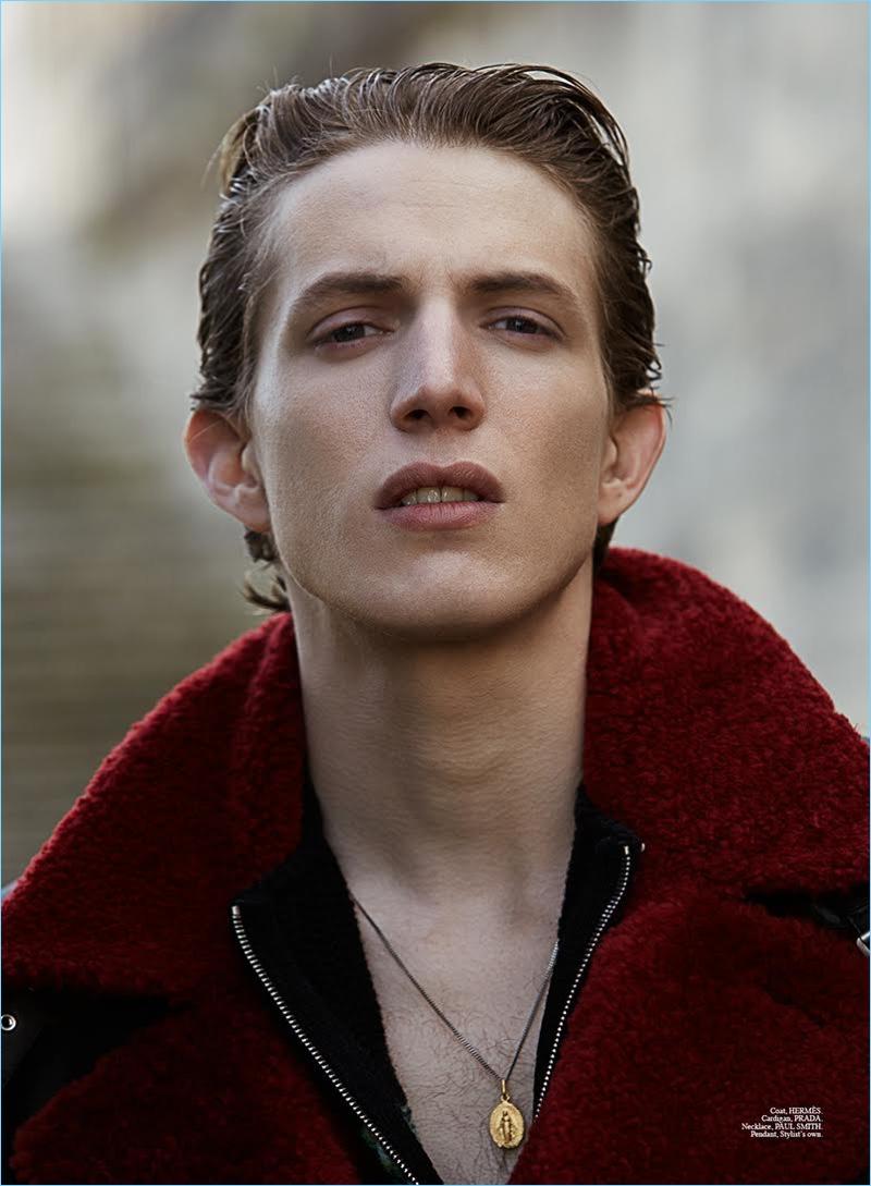 Xavier Buestel wears a Hermes coat, Prada cardigan, and Paul Smith necklace for Summerwinter magazine.