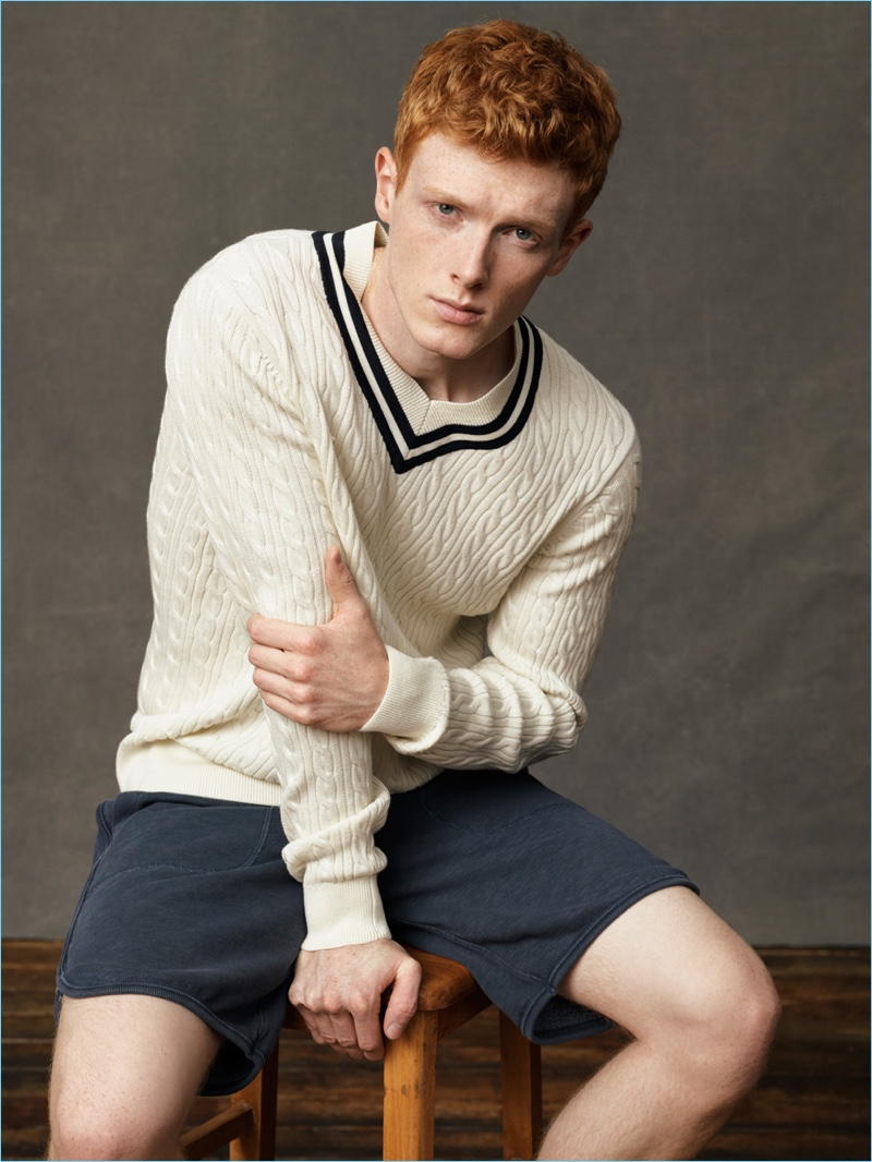 Front and center, Linus Wordemann wears a varsity sweater and shorts by Abercrombie & Fitch.