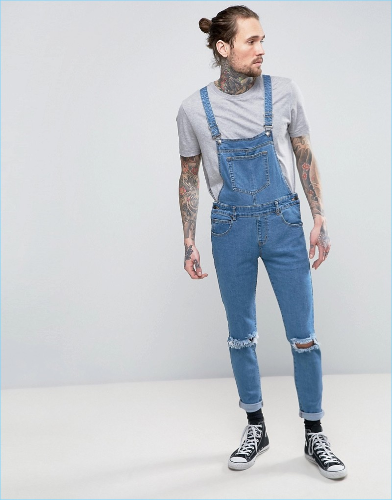 a3f964e481c2 Always Rare s denim overalls provide a slim-fit and trendy ripped knees.