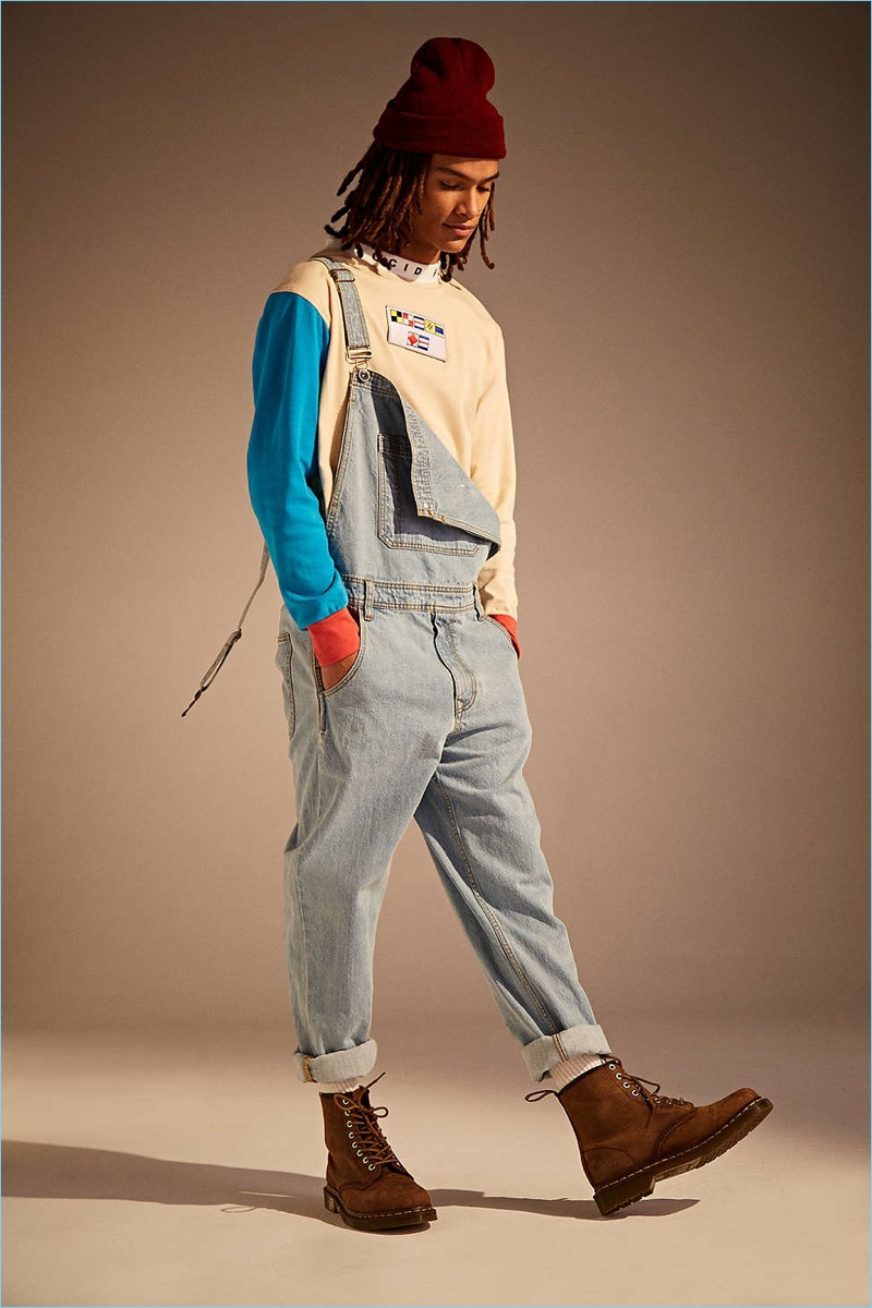 Take a style note from Urban Outfitters and wear BDG's light stone wash overalls with one strap undone.