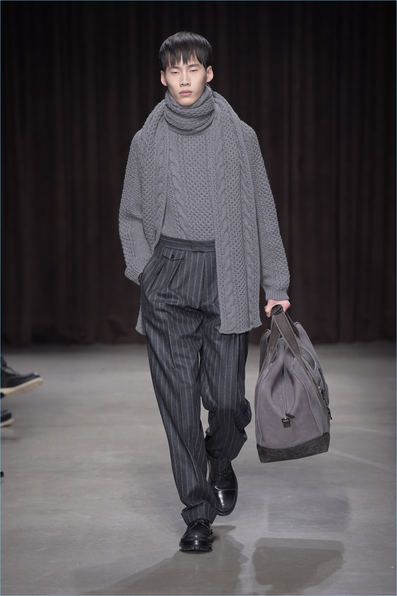 German brand BOSS Hugo Boss produces a cable-knit sweater with a matching scarf for fall-winter 2017.