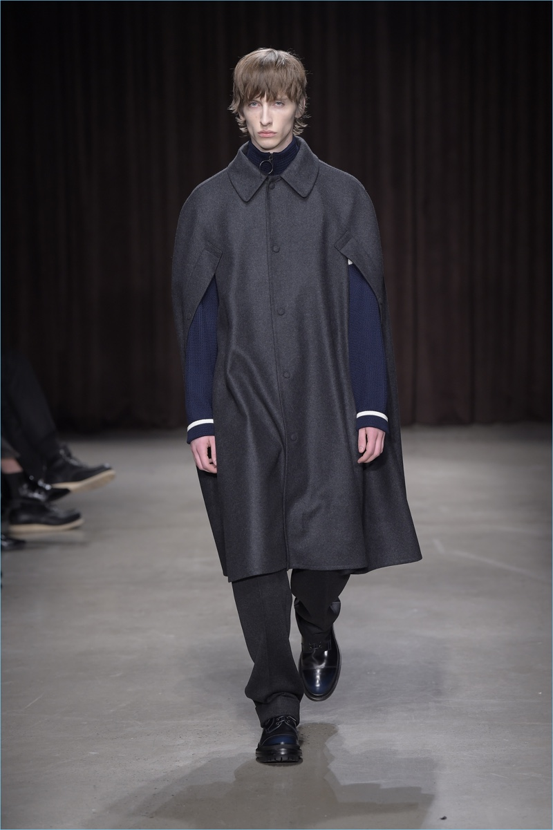 BOSS Hugo Boss goes chic with a cape for fall-winter 2017.
