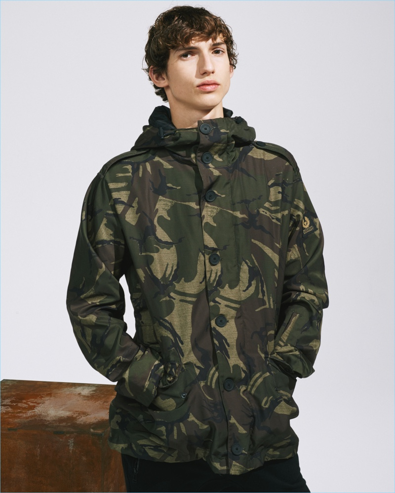 A parka embraces an all-over camouflage print for Belstaff's SOPHNET collaboration.