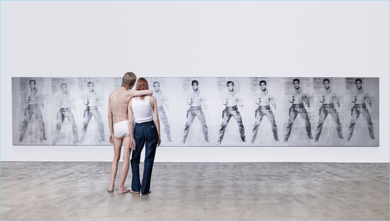Jonas Gloer and Kiki Willems view Andy Warhol's Elvis 11 Times for Calvin Klein's American Classics campaign.