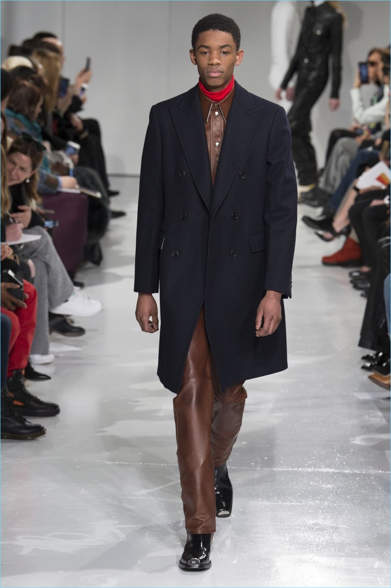 Leather and tailoring come together for a standout fall-winter 2017 look by Calvin Klein Collection.