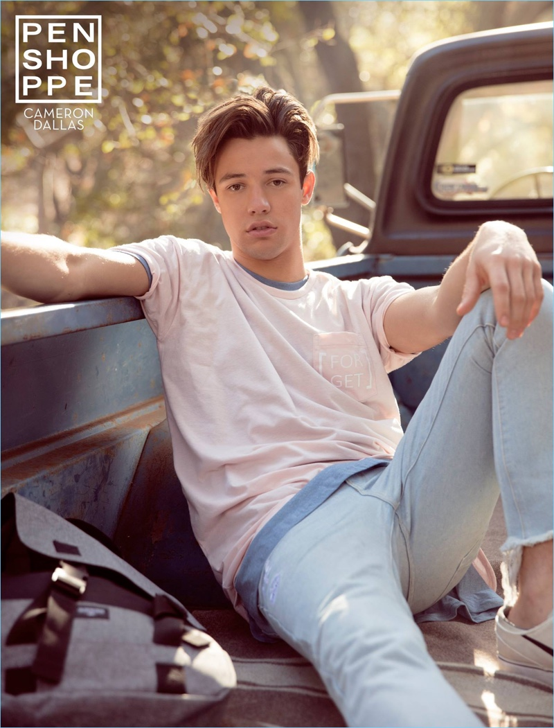 Relaxing in the back of a pickup truck, Cameron Dallas appears in Penshoppe's spring-summer 2017 campaign.