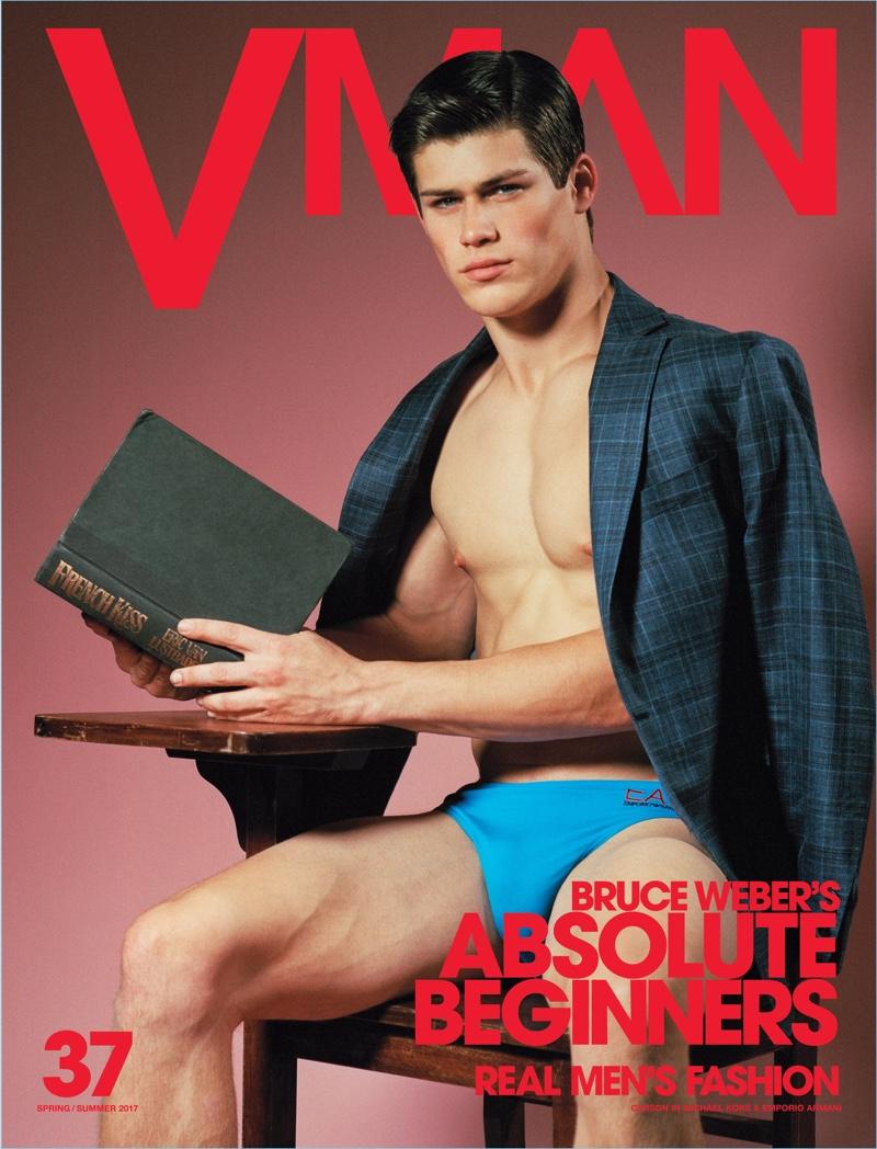 Carson Aldridge wears an EA7 swimsuit for the cover of VMAN.