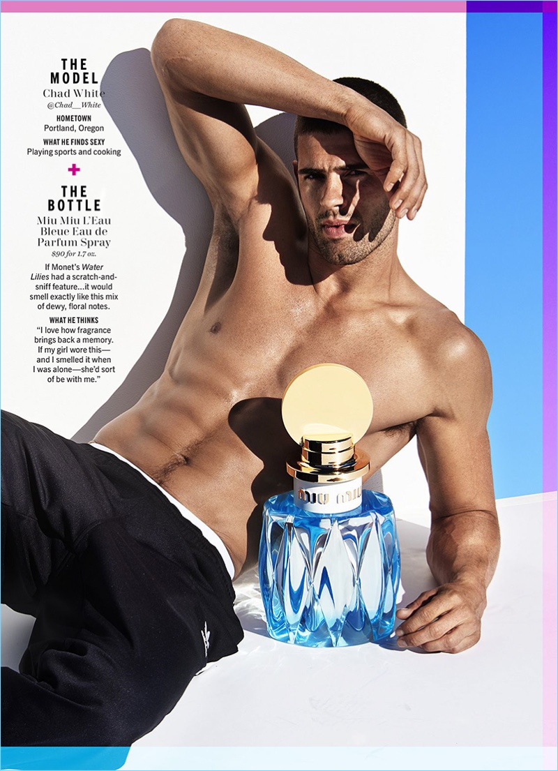 Chad White goes shirtless with an oversized bottle of Miu Miu L'Eau Bleue.