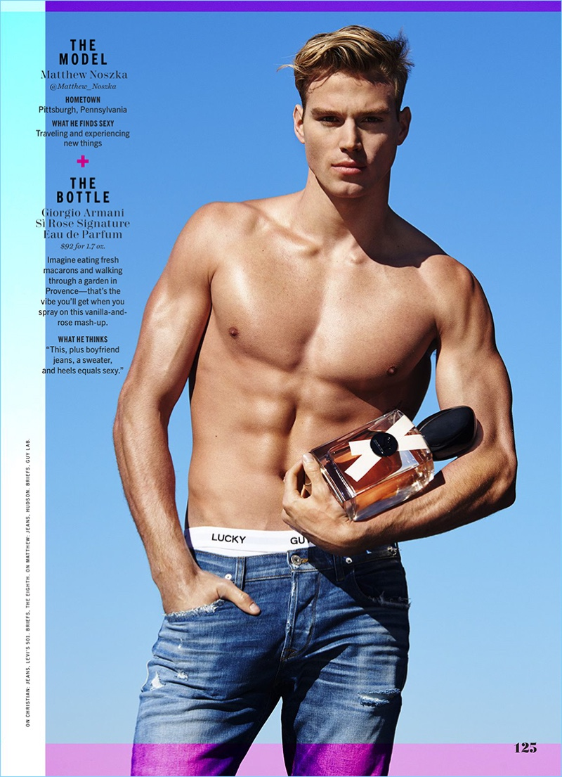 Matthew Noszka shows off his six-pack as he poses with a bottle of Giorgio Armani Si Rose Signature.