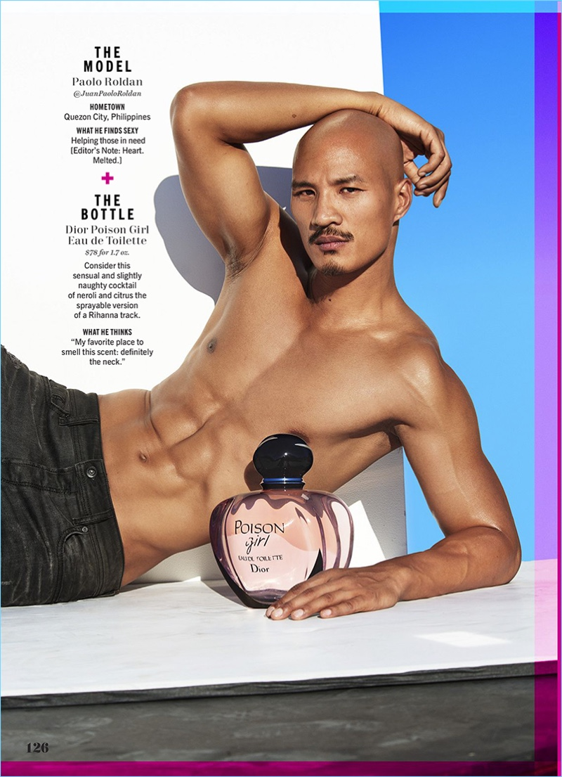 Laying with a bottle of Dior Poison Girl, Paolo Roldan flexes his biceps.