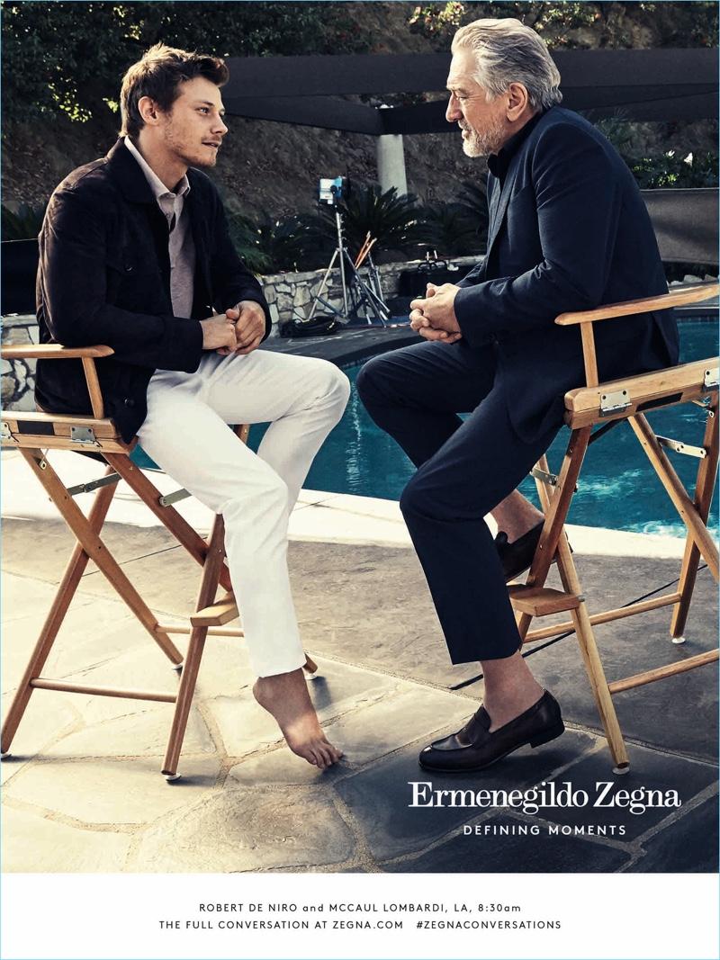 Actors McCaul Lombardi and Robert De Niro enjoy a chat poolside for Ermenegildo Zegna's Defining Moments campaign.