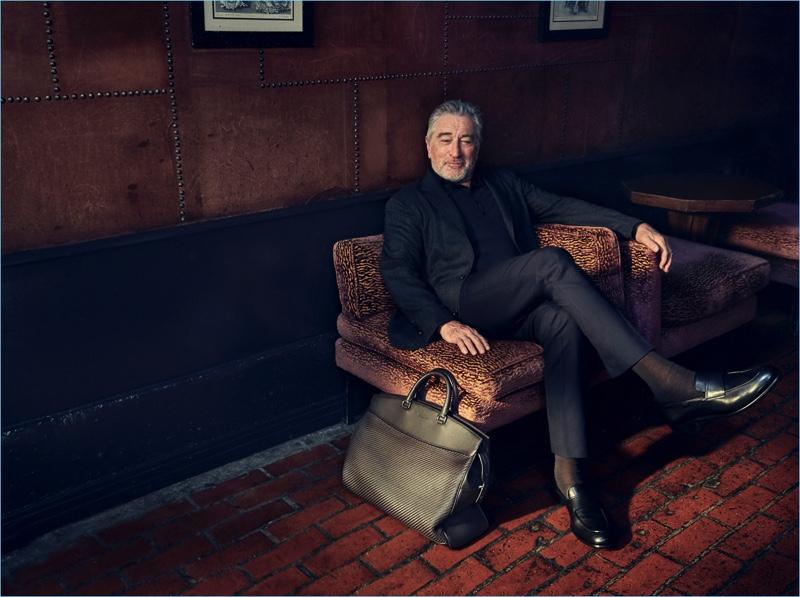 Actor Robert De Niro retreats indoors for a sartorial moment in Ermenegildo Zegna tailoring.