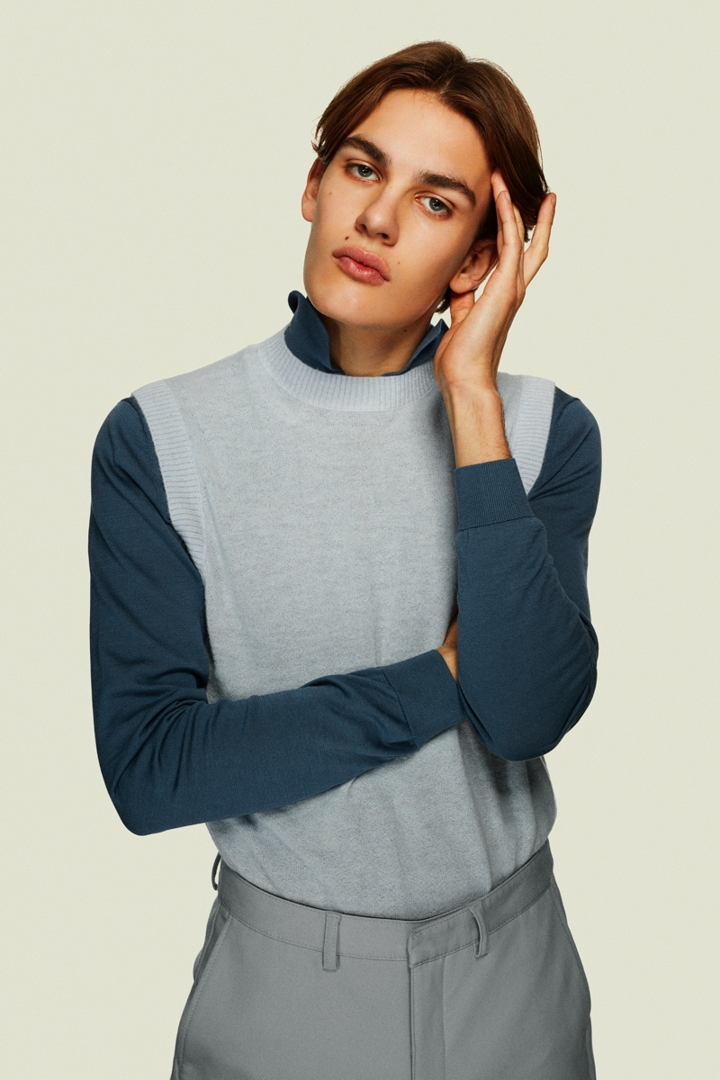 frederik wears polo hum sweater vest cos and pants