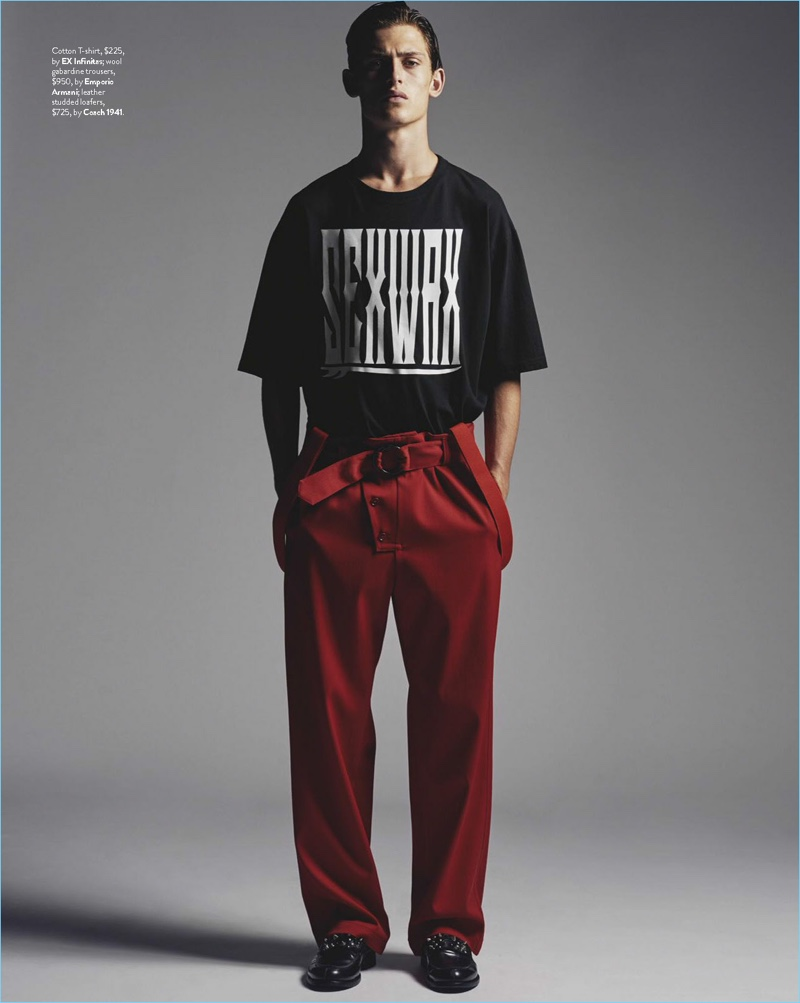 Making a casual statement, James Manley sports an EX Infinitas t-shirt with red Emporio Armani trousers and Coach 1941 loafers.