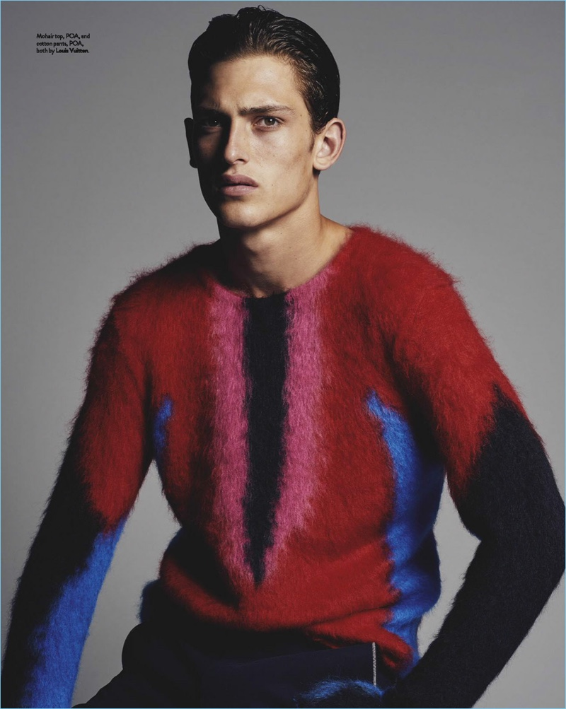 James Manley wears a graphic sweater and trousers by Louis Vuitton.