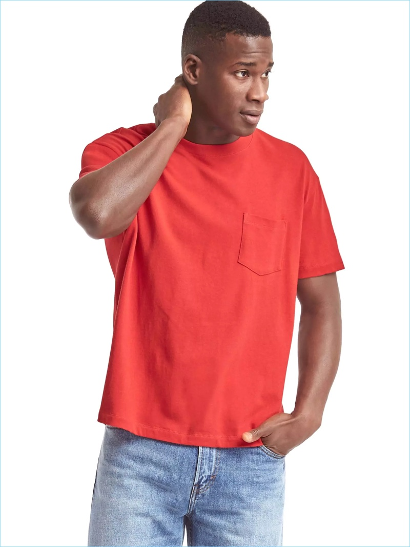 Model David Agbodji goes casual in an original red pocket tee from Gap's Archive Re-Issue collection.
