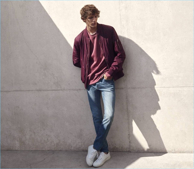H&M enlists model Xavier Buestel for its denim lookbook, which features a casual bomber jacket, scuba-look sweatshirt, t-shirt, slim regular jeans, and white sneakers.