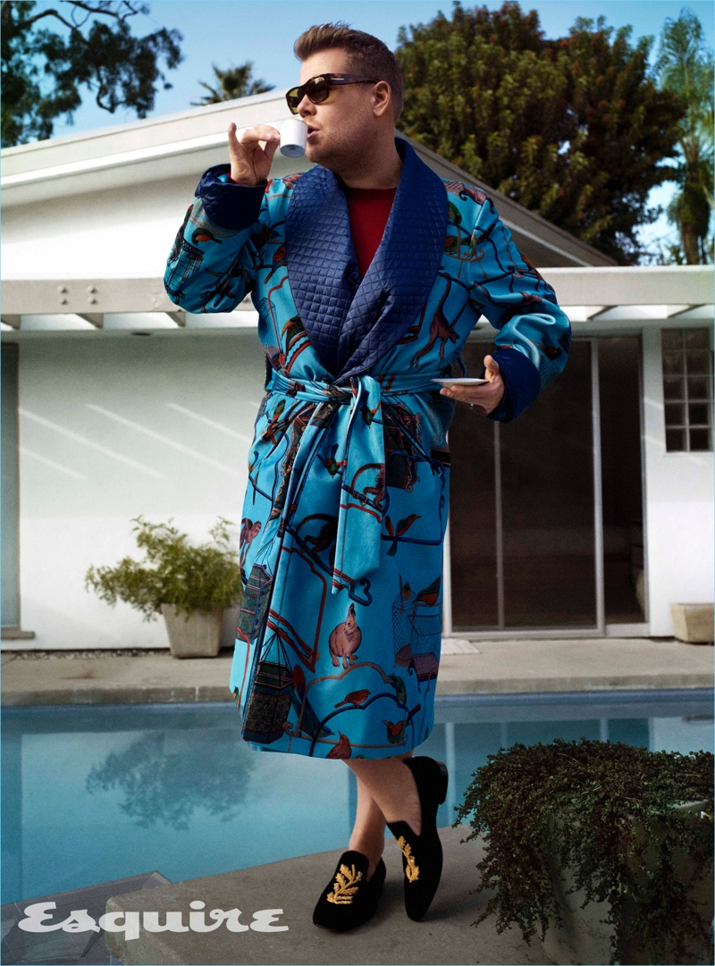 Late night host James Corden wears a New & Lingwood robe with a sweater and loafers by Burberry. Corden also rocks Tom Ford sunglasses.