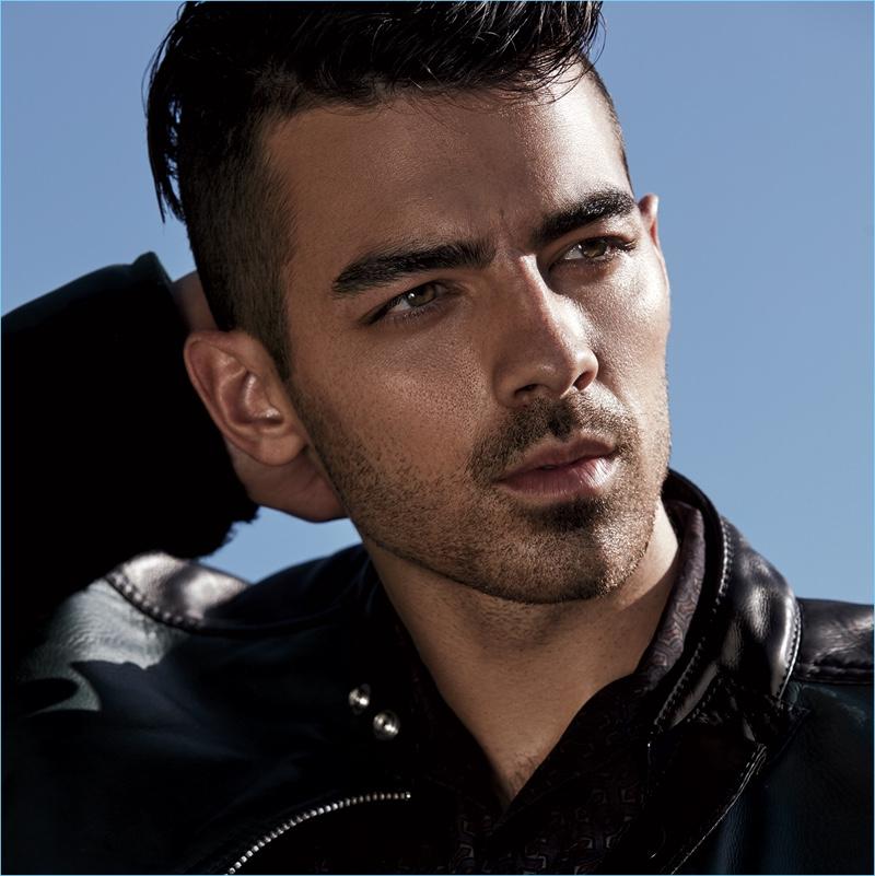 Singer Joe Jonas wears a Fendi jacket with a Lanvin shirt.