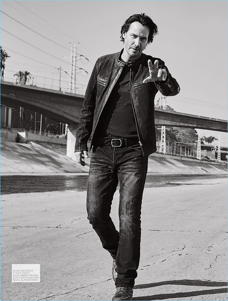 Sporting a Belstaff leather jacket, Keanu Reeves also wears a Vince t-shirt, Apline Stars boots, and Fabric Brand & Co. jeans.