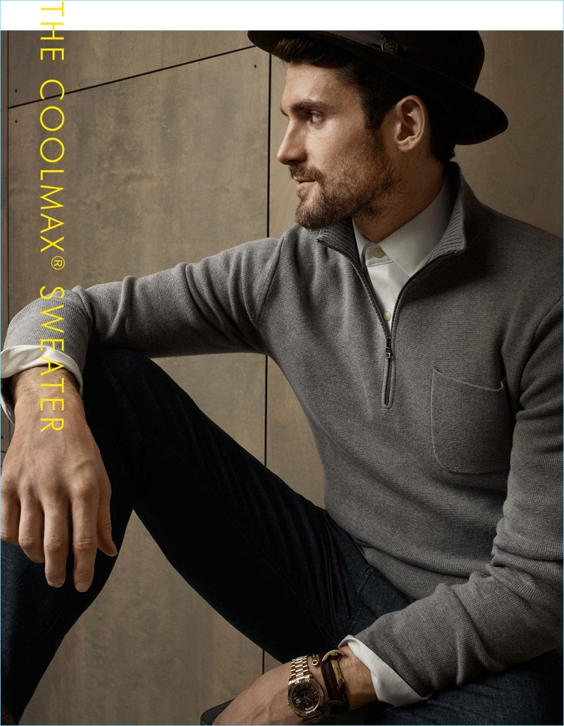 Basketball player Kevin Love plays its cool in a fedora. Love sports Banana Republic's half-zip sweater over a shirt with casual brands.