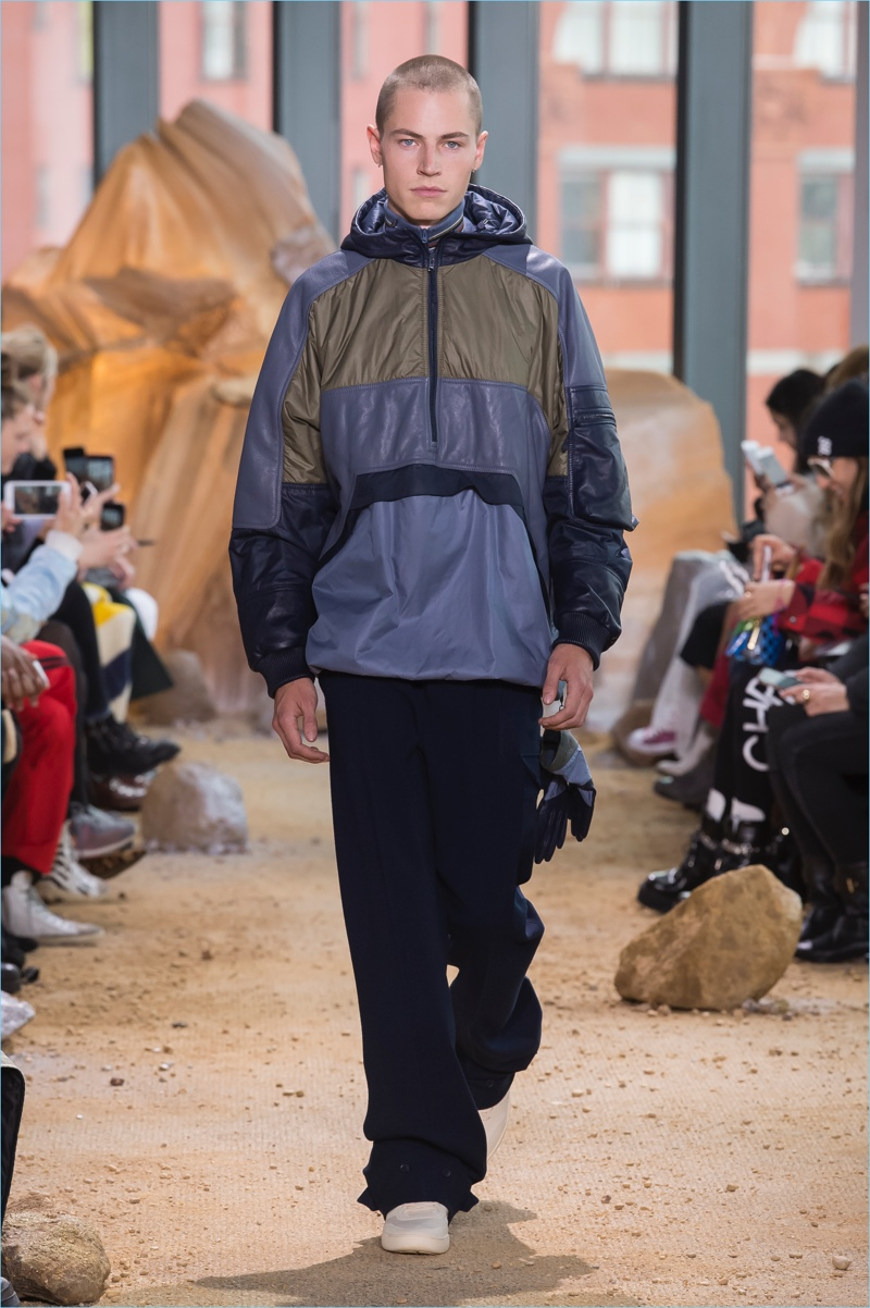 Lacoste embraces a sporty relaxed silhouette for its fall-winter 2017 men's collection.