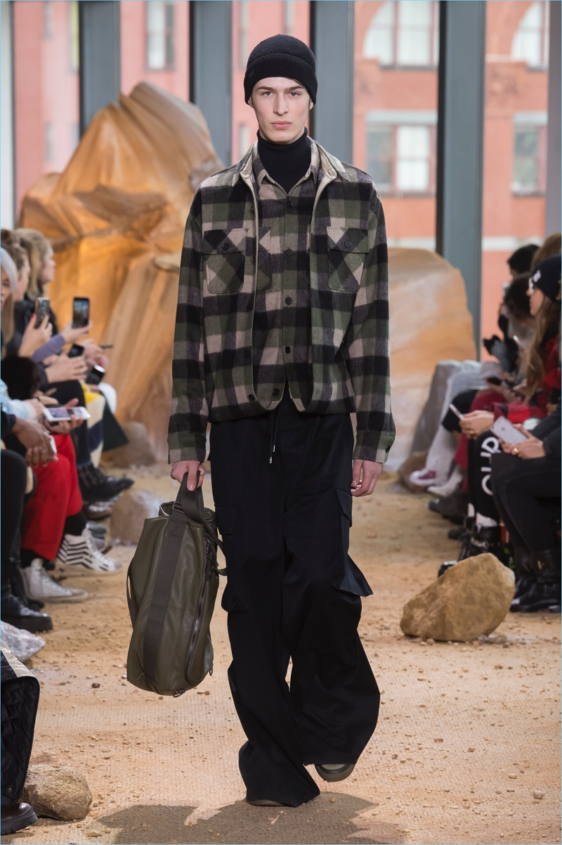 Baggy pants make a comeback as Lacoste pairs the statement piece with plaid outerwear.